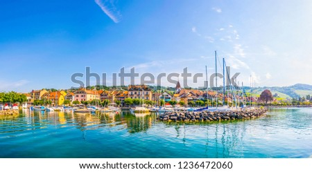LUTRY,  SWITZERLAND, JULY 18, 2017: People are enjoying a sunny summer day in port at Lutry, Switzerland
