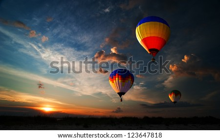 Colorful hot air balloon is flying at sunrise #123647818