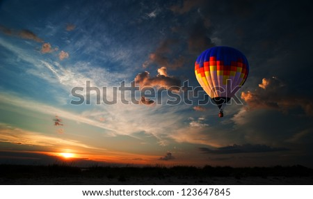 Colorful hot air balloon is flying at sunrise #123647845