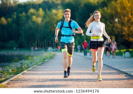 Image of sports men and women running in park #1236494176