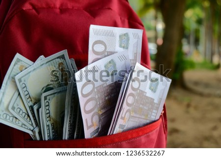 500 euro banknotes and 100 coins worn in a shoulder bag. #1236532267