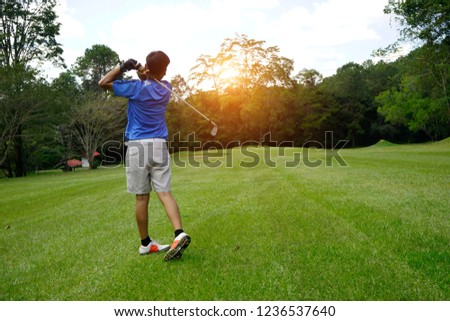 Blurred Golfer playing golf on beautiful golf course in the evening golf course with golfcar background #1236537640