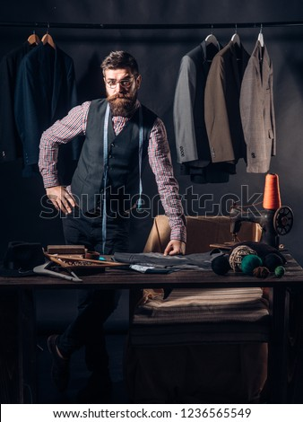 Tailor at work. retro and modern tailoring workshop. sewing mechanization. business dress code. Handmade. Bearded man tailor sewing jacket. suit store and fashion showroom. Talented tailor. #1236565549