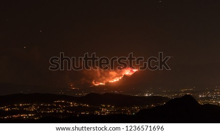Firestorm Fire and clouds Woolsey Fire Hill in Los Angeles Malibu California Post Apocalyptic  #1236571696