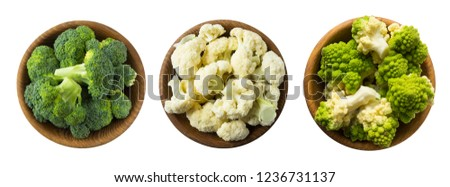 Broccoli, cauliflower and roman cauliflower in wooden bowl isolated on a white background. Vegetables with copy space for text. Three bowls of cabbage on a white background. Set of cabbage. Top view.  #1236731137