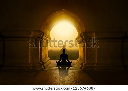 Man with yoga pose in buddhist temple #1236746887