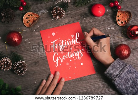 Hand writing greeting card Merry Christmas text with Christmas decoration on wood table. #1236789727