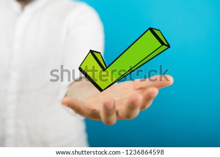 green checkmark in hand #1236864598