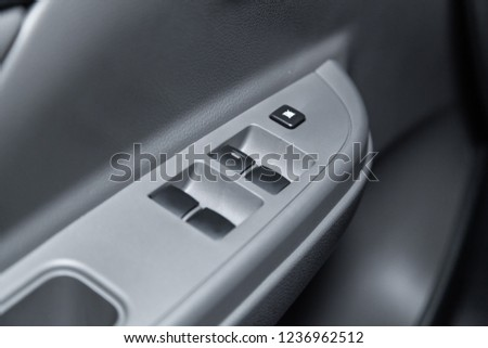 Novosibirsk, Russia - November 20, 2018:  Mitsubishi L200, close-up of the side door buttons. Photography of a modern car on a parking in Novosibirsk #1236962512