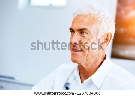 Portrait of a handsome senior man indoor #1237034806