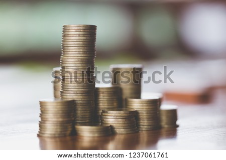 Close up of coins to stack of coins,  Business Growth concept, There is money coins to stack of coins. Financial risk. #1237061761