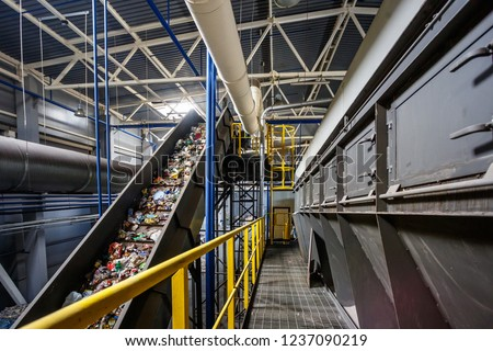 moving conveyor transporter on Modern waste recycling processing plant. Separate and sorting garbage collection. Recycling and storage of waste for further disposal.  #1237090219