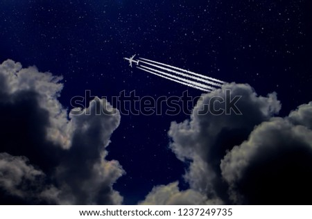 Jet plane and contrail in the night starry sky #1237249735