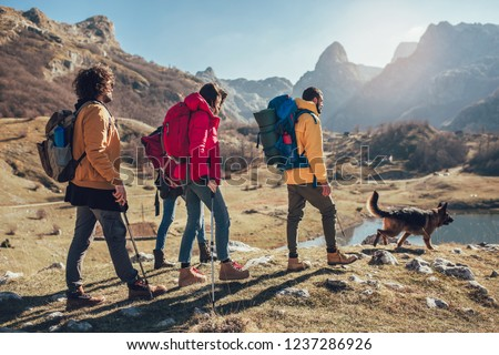 Group of hikers walking on a mountain at autumn day  #1237286926