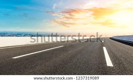 Panoramic city skyline and buildings with empty asphalt road at sunset #1237319089