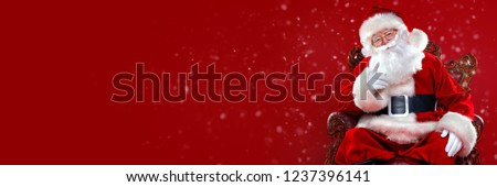 Christmas and New Year concept. Portrait of good old Santa Claus sitting in his armchair. Red background. #1237396141