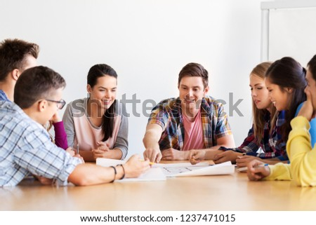 education, architecture and people concept - group of smiling students meeting at school #1237471015