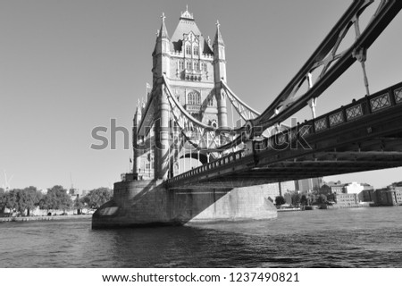 Monochrome image of the London tower bridge and Thames