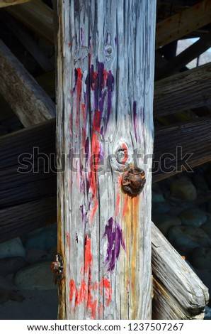 A colored wooden pole underneath a beach house in Malibu, Los Angeles, California #1237507267