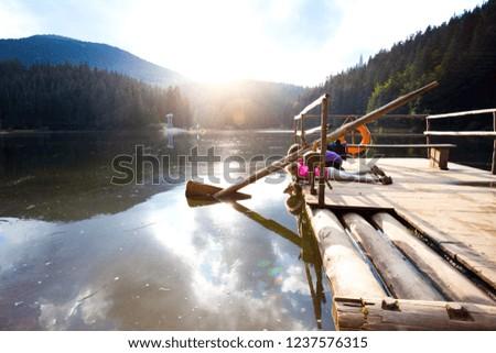kids tourist girls on a mountain lake. Carpathians,  Ukraine. #1237576315