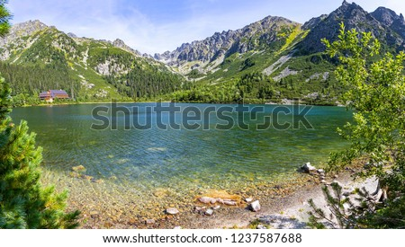 Picturesque panoramic view of Popradske Pleso, High Tatras mountains, Slovakia. Popradske pleso is a mountain lake of glacial, situated right on the path of Tatranska magistrala, at altitude of 1494m #1237587688