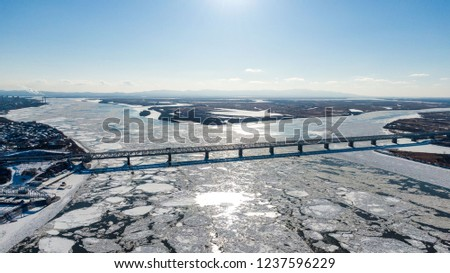 Khabarovsk bridge-road and railway bridge that crosses the Amur river in the city of Khabarovsk in the East of Russia. photos from the drone #1237596229