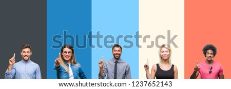 Collage of group of young people over colorful vintage isolated background showing and pointing up with finger number one while smiling confident and happy. Royalty-Free Stock Photo #1237652143