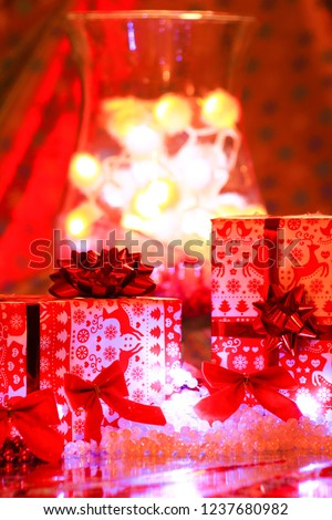 group of gifts packs of birthday in front of bokeh background red and yellow #1237680982
