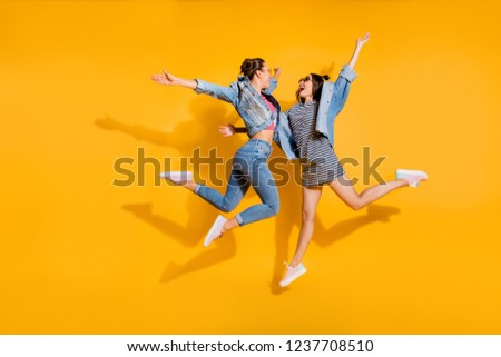 Full legs body size portrait of two sweet gorgeous glad positive nice adorable good-looking lady in glasses spectacles ready hug each other jump isolated on yellow shine background raised hands up #1237708510