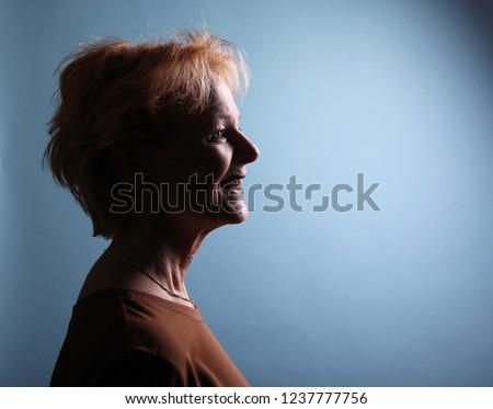 Mature woman with orange hair #1237777756