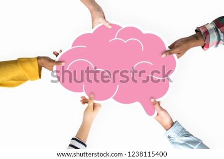 Diverse hands holding a brain cardboard prop Royalty-Free Stock Photo #1238115400