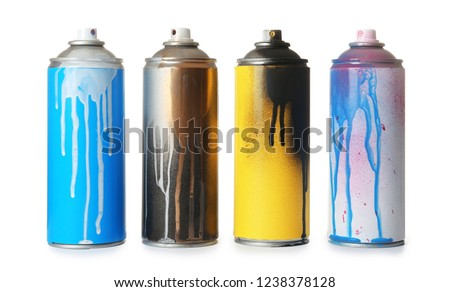 Used cans of spray paint on white background Royalty-Free Stock Photo #1238378128