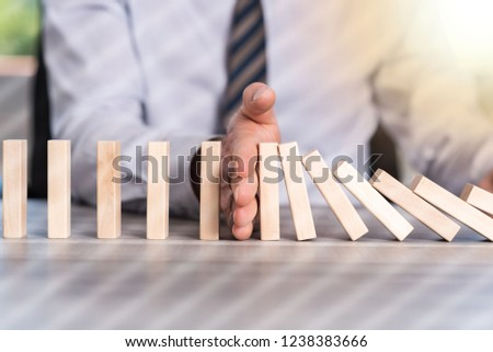 Business control concept by stopping domino effect, light effect #1238383666