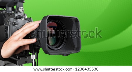 Cameraman with his camera on white background #1238435530