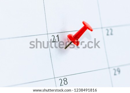 calendar entry. Number 21 day pinning with Red color pin thumbtack. Save the Date concept. #1238491816