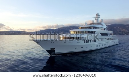 A huge motor yacht underway Royalty-Free Stock Photo #1238496010