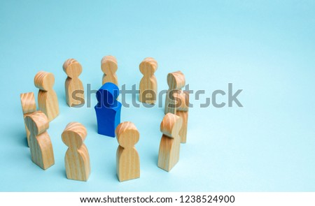 The concept of leadership in a business team. A crowd of workers stand in a circle and listen to their mentor, leader or boss. Improving work efficiency and developing a future action plan in the team #1238524900