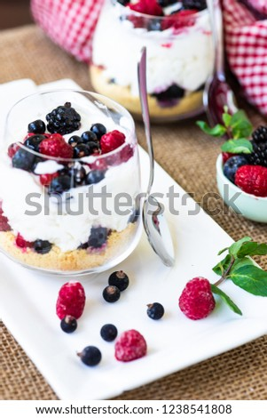 Yogurt dessert with granola and berries on rustic background #1238541808