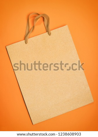 Gift bag on orange. Flat composition with copy space #1238608903