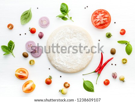The ingredients for homemade pizza on white wooden background. Royalty-Free Stock Photo #1238609107
