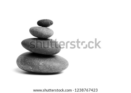 Stacked smooth grey stones. Sea pebble. Balancing pebbles isolated on white background #1238767423