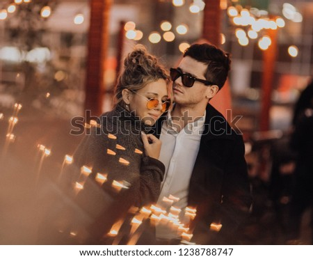 Smiling couple of travelers in cool sunglasses . Happy people relax in city. Back light. #1238788747