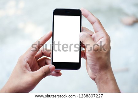 Cropped shot view of man hands holding smart phone with blank copy space screen for your text message or information content, female reading text message on cell telephone during in urban setting. #1238807227