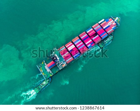 Aerial top view of cargo container ship and trug ship working dragging vessel to yard port concept freight shipping ship , logistic service and transportation. #1238867614