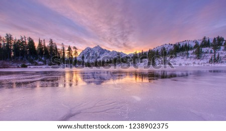 Mt Shuksan reflecting in frozen Picture Lake.