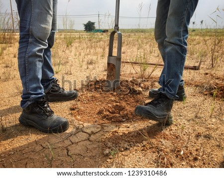 Soil boring and soil sampling by Soil drill. The concept of soil quality and environmental research #1239310486