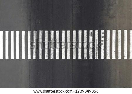 Aerial. Pedestrian crosswalk zebra with no pedestrians. Top view. #1239349858