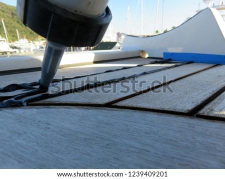 Caulking process on the teak deck #1239409201