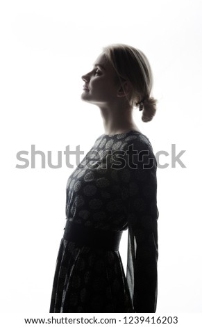Silhouette of woman's  with back light #1239416203