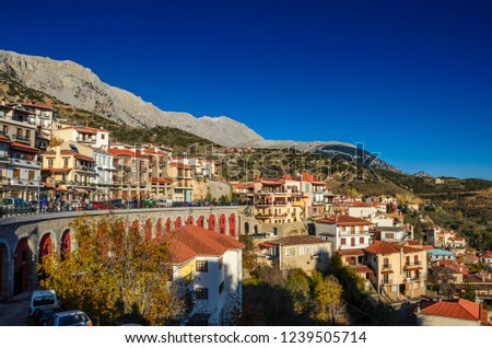 Scenic view of Arachova Village. Arachova is famous for its panoramic view, uphill small houses and the cobbled streets show a picturesque architecture at Parnassos Mountain Boeotia - Greece, Europe #1239505714